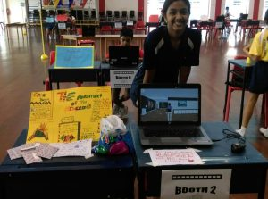 A Student demonstrates the game she designed using 3DHive